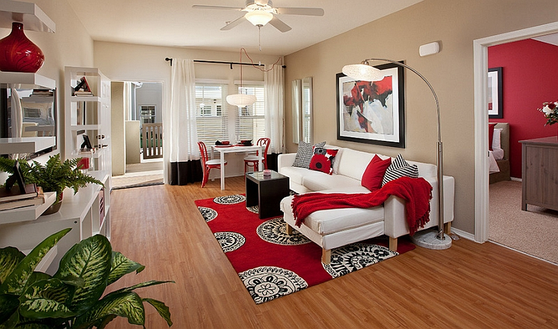 Black and white living room with red