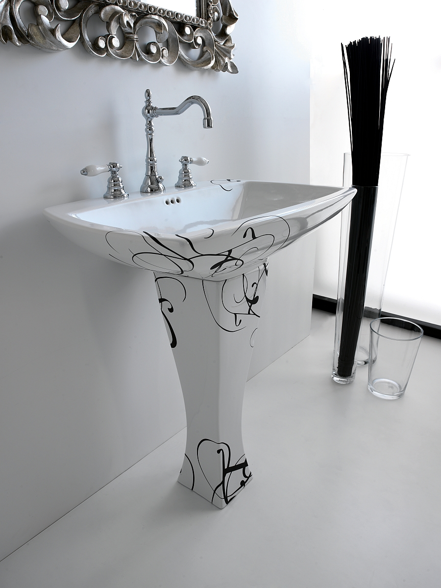White washbasin with intricate pattern in black and a classic design