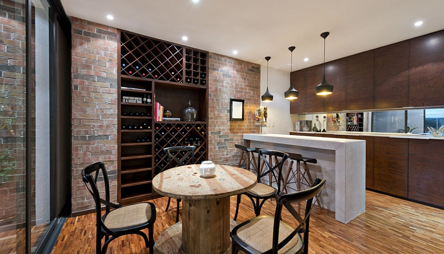 Wine storage in the kitchen adds visual contrast to the space