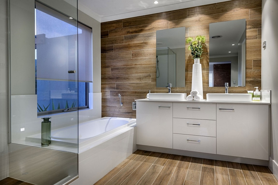 Wooden panel flooring and walls give the spa-like bath an inviting appeal