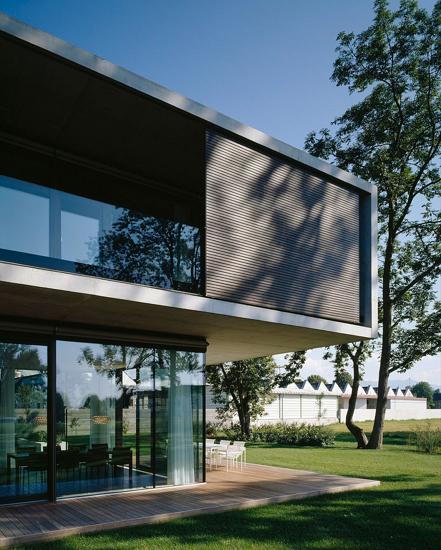 Wooden slats coupled with glass offer both privacy and ventilation