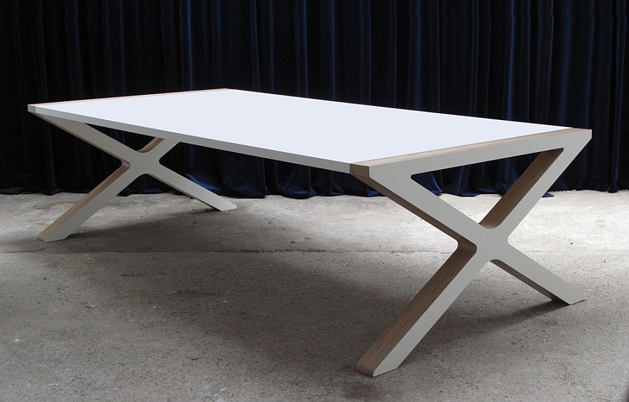 X Dining table adds geometric contrast to the contemporary dining space