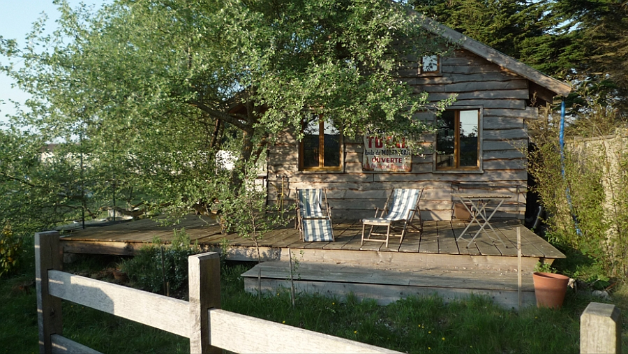A relaxing view of the outdoor from the cabin in Normandy Tiny Holiday Cabin In Normandy Charms With Its Disarming Rustic Goodness!