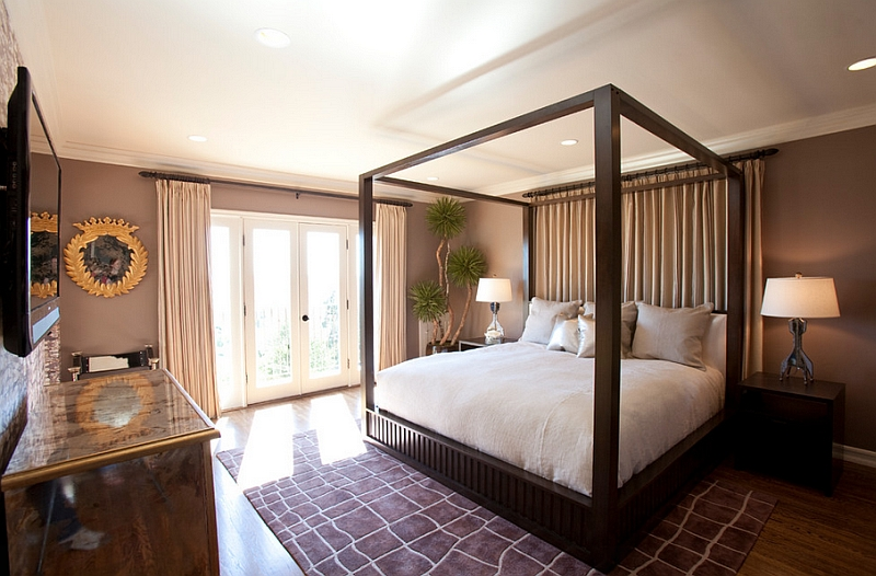 A touch of greenery in the corner adds to the Hollywood appeal of the bedroom
