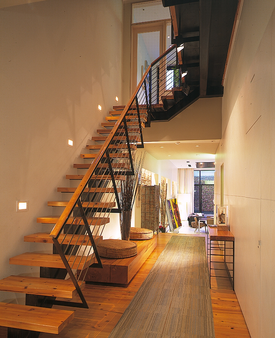 Addition of wooden staircase brings visual warmth to the house Audacious Renovation Turns Old Coal Garage Into A Dramatic NYC Townhouse