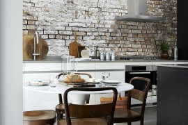 Aged brick wall wallpaper in the kitchen combines two hot design trends!