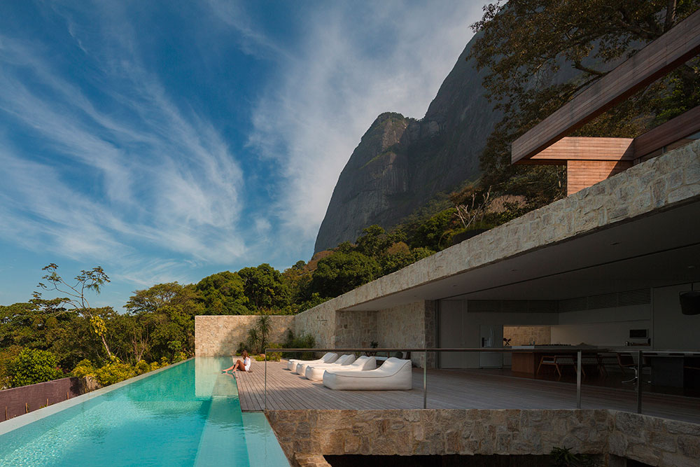 Dramatic rio de janeiro home enthralls with amazing ocean views and minimal flair by sherry nothingam