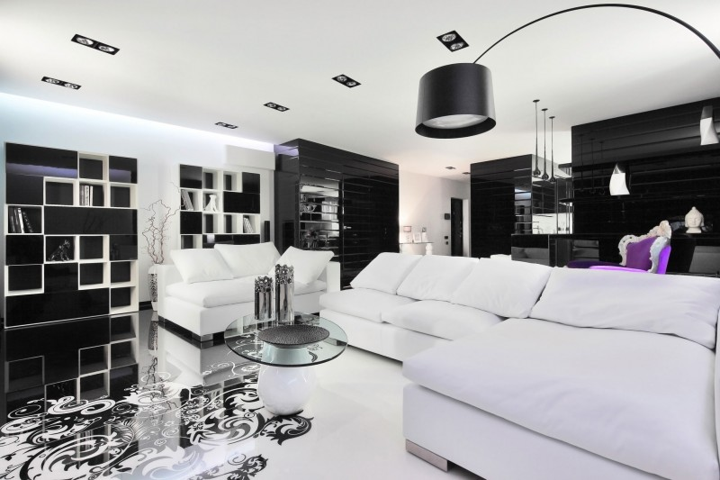 Amazing black and white living room with lone purple chair in the backdrop