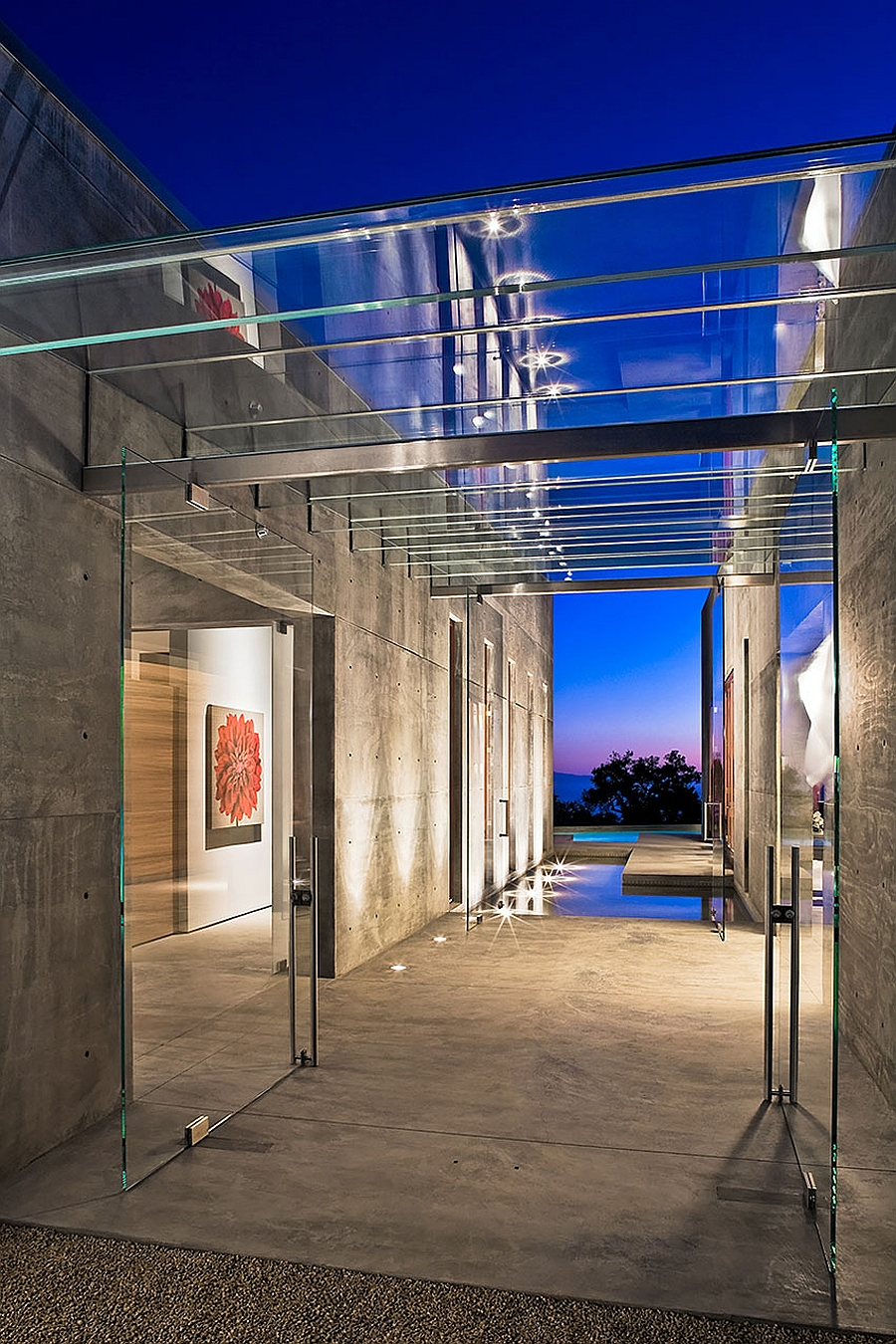 Amazing glass entry pavilion between the living and the carport units