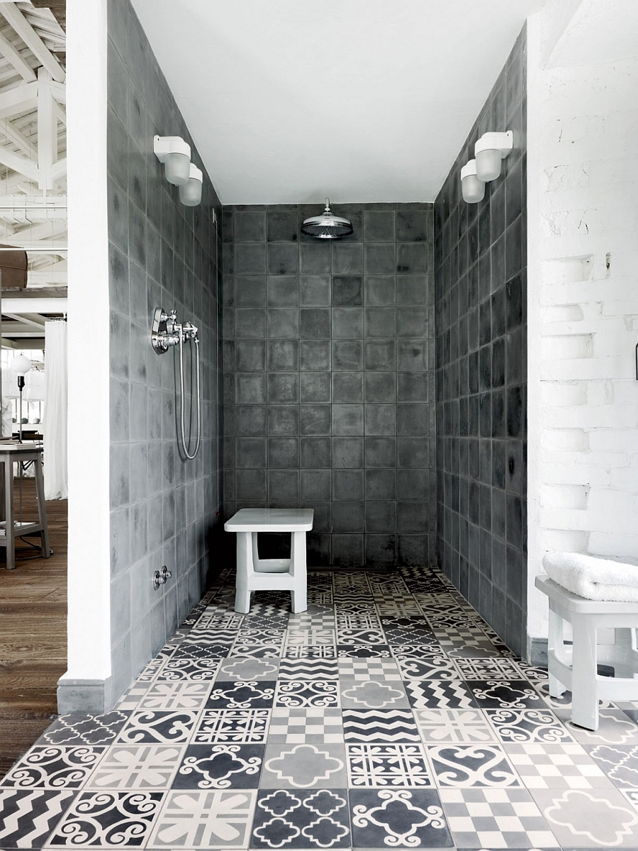 Amazing use of tiles in different patterns of white and grey in the stunning shower area