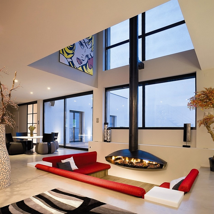 Antefocus fireplace enlivens this cool and elegant sunken lounge