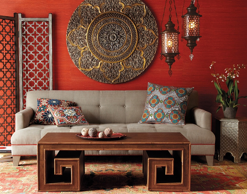 table and ornate details shape this chic living room in bold colors