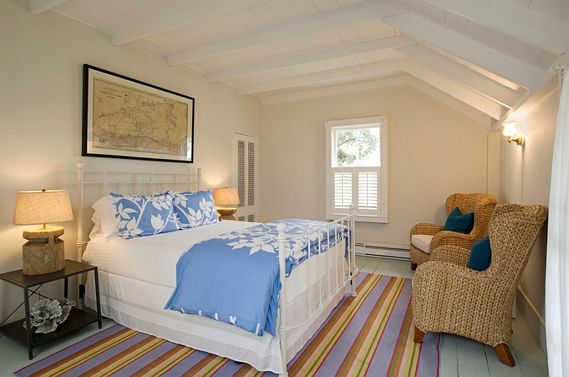 Beach style bedroom makes the best possible use of the distinct contours of the room