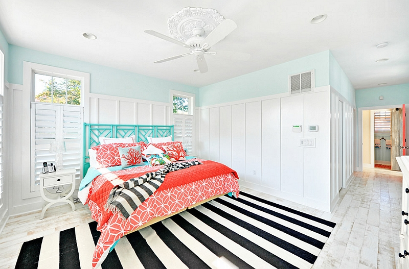 Beach style bedroom with a striped rug and fabulous coral and aqua accents