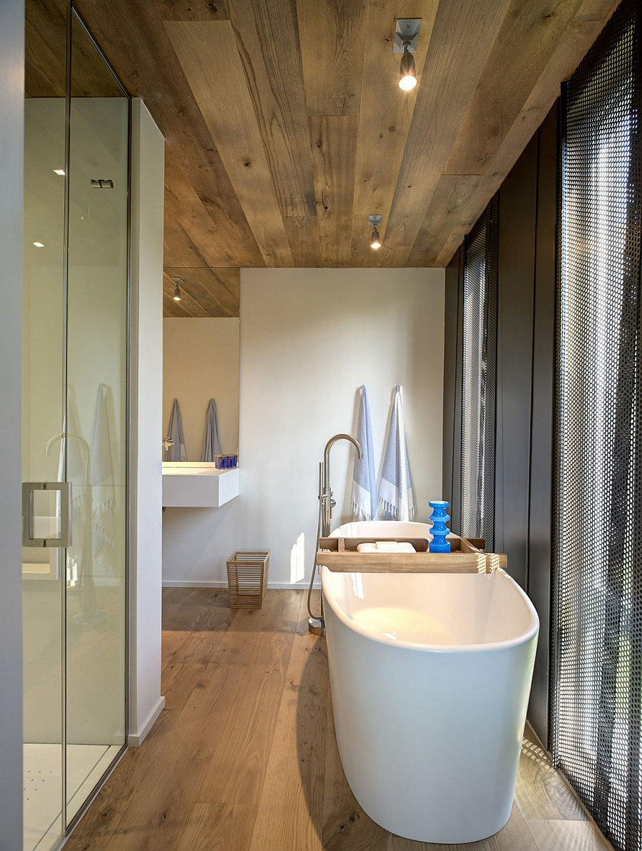 Beautiful bath with a stylish standalone tub and blue accents