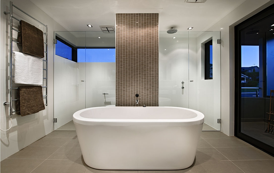 Beautiful contemporary bath with a standalone tub and a smart shower area in the backdrop