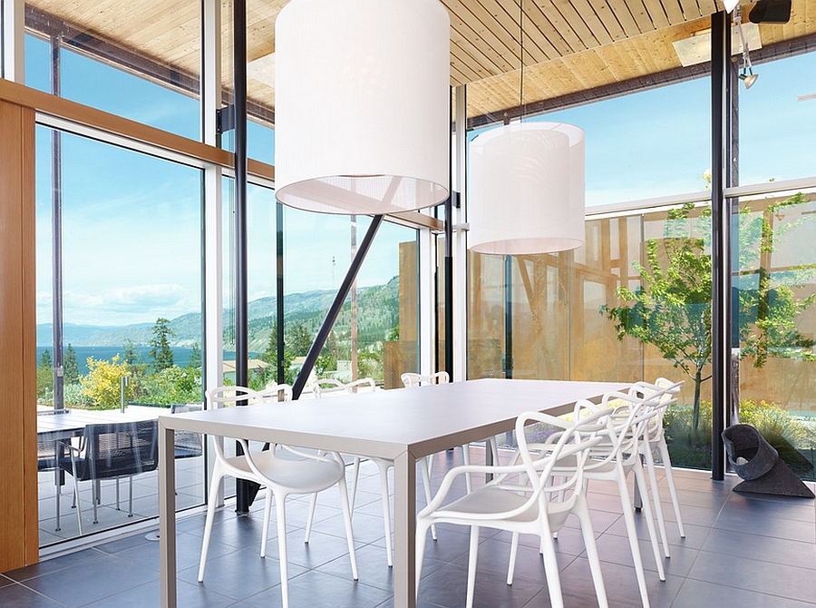 Beautiful dining room with stunning views that draw your attention outside [Photography by Martin Knowles Photo/Media]