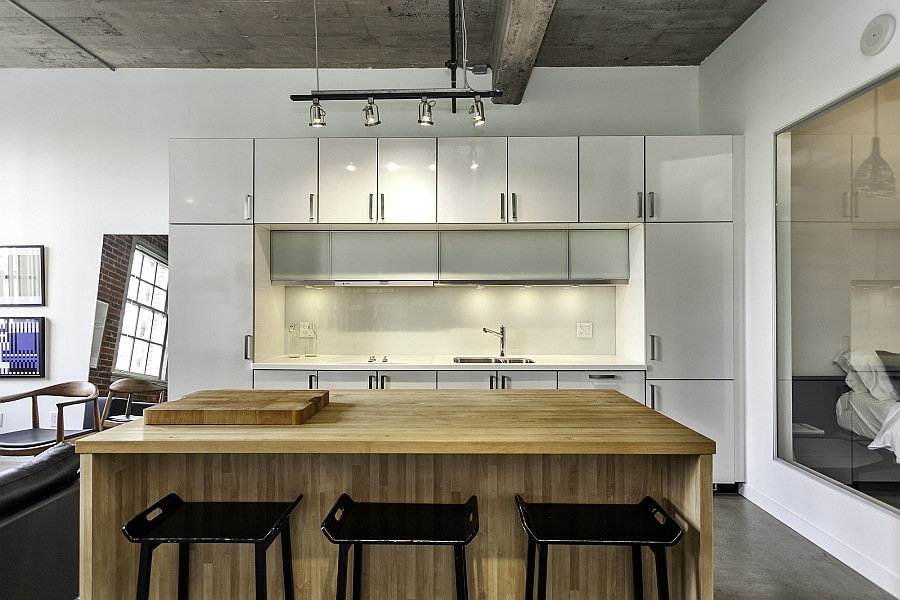 Beautiful kitchen with exposed concrete ceiling and track lighting