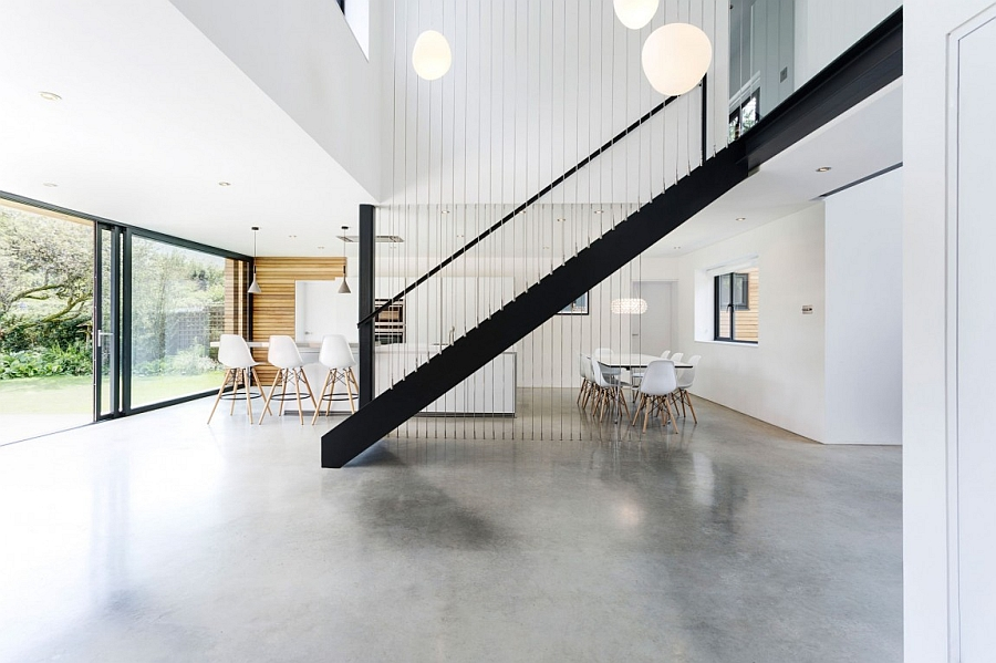 Beautiful metal staircase adds sculptural value to the interior