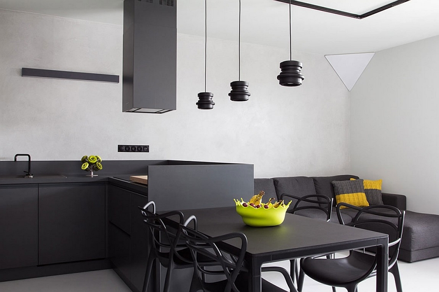 Beautiful pendant lights above the dining table move away from the modern trend of large pendants