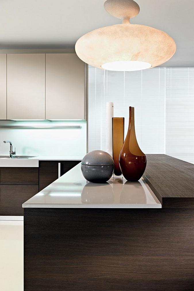 Beautiful pendant lights add visual drama to the kitchen