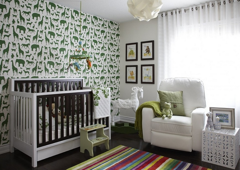 Beautiful wallpaper and the antique painted horse in the corner steal the show in this nursery