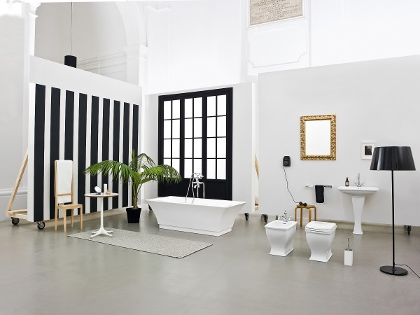 Black and white stripes and pops of gold bring sophistication to the trendy bathroom