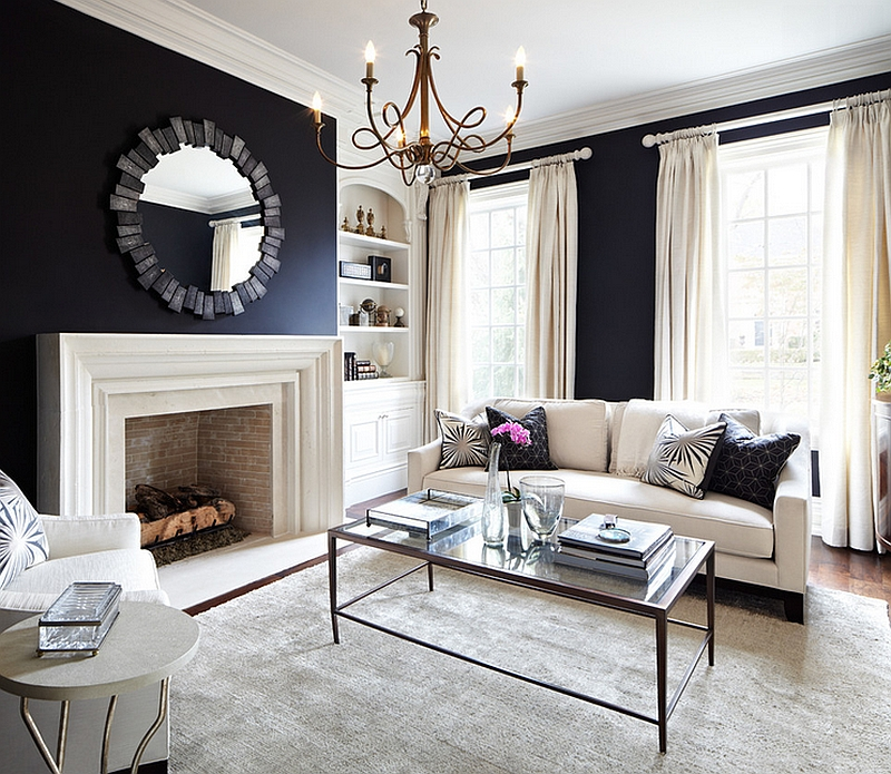 Black walls add a sense of coziness and grandeur to the living room