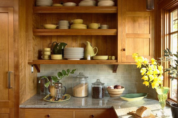 Blossoms, plants and produce in a warm-toned kitchen