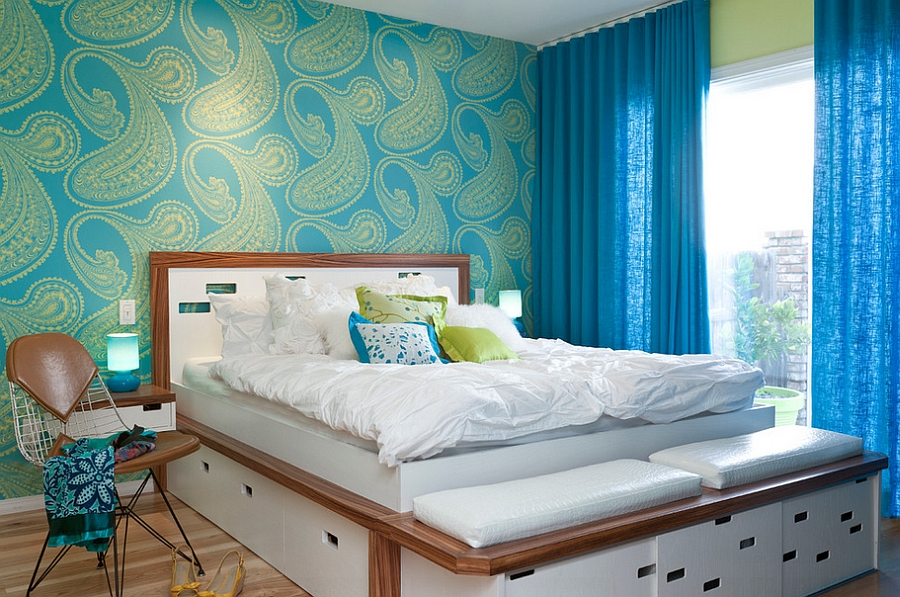 Bold and colorful wallpaper and drapes shape the gorgeous bedroom
