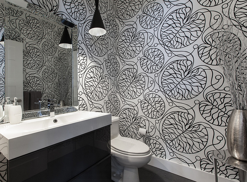 Bold wallpaper from Marimekko adds stunning appeal to the black and white bathroom