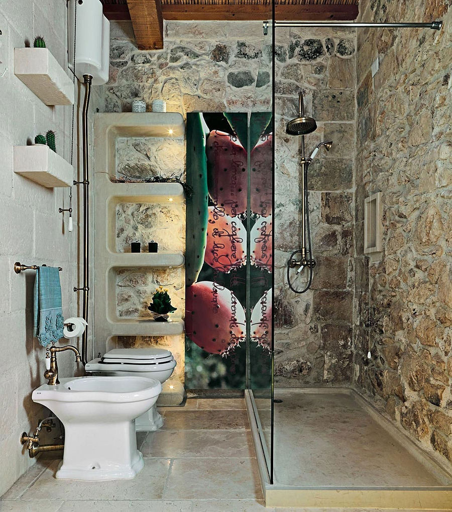 Brass accents in the bathroom bring life to the rustic bathroom