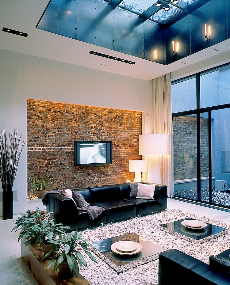 Brick accent wall in the living space gives the room a unique look