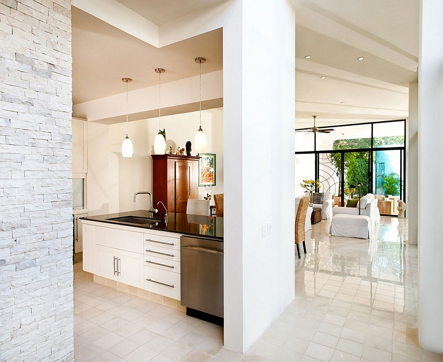 Brick wall backdrop of the contemporary kitchen