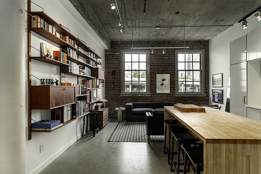 Brick walls and exposed concrete preserve the original appeal of the renovated apartment