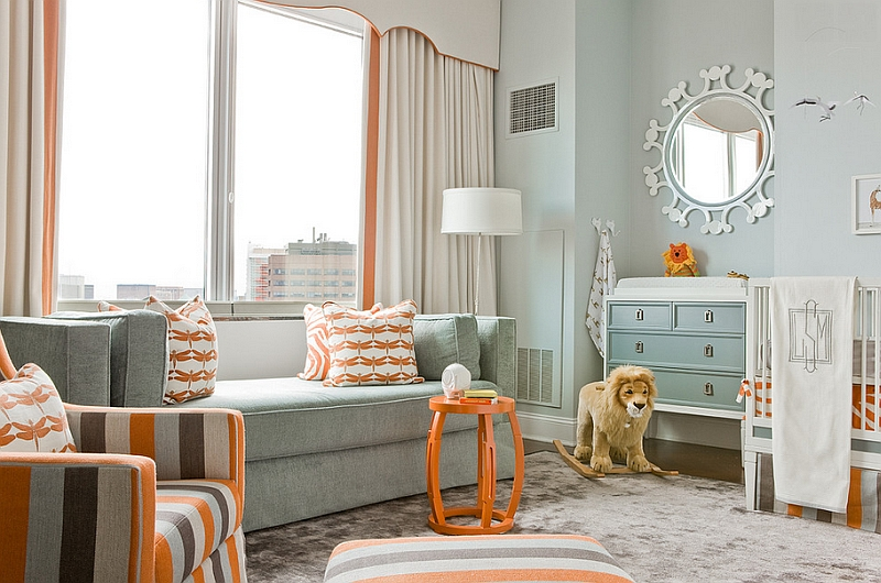 Bright orange decor additions look amazing in a nursery with a cool, neutral backdrop
