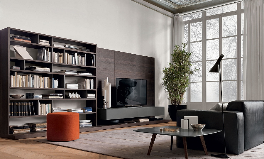 Bright orange ottoman adds a splash of color to the room with stunning wall unit system Resourceful Living Room Wall Unit Adapts To Suit Your Dynamic Urban Lifestyle