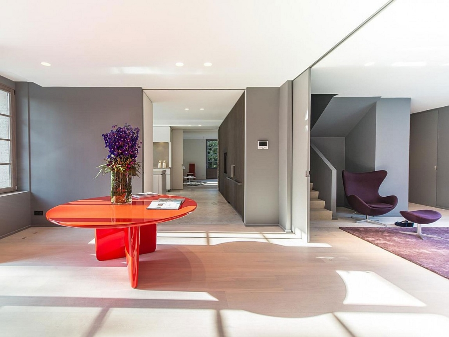 Bright pops of orange and purple enliven the lavish ground level of the villa