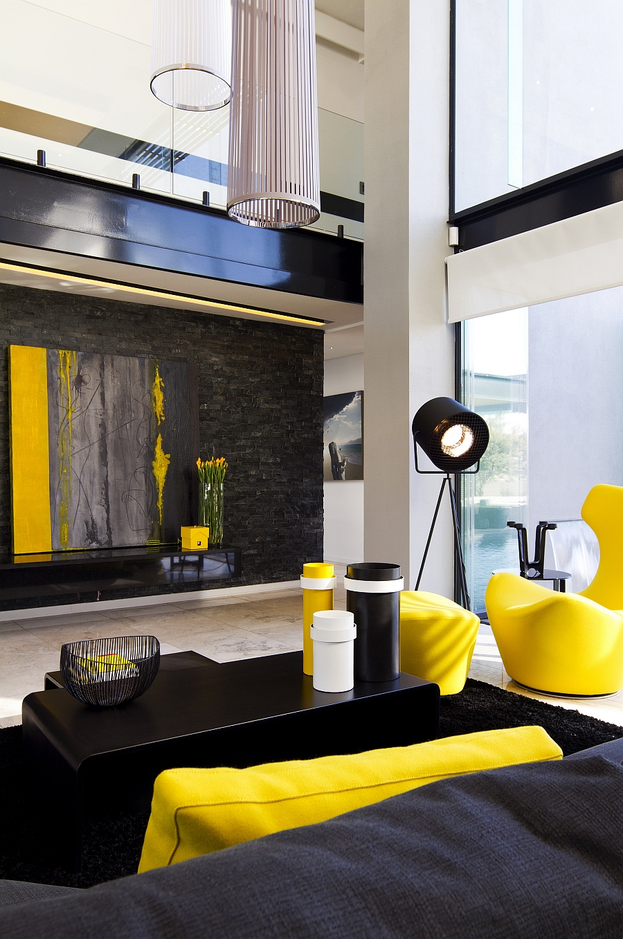 Bright yellow accents enliven the contemporary living room with dark hues