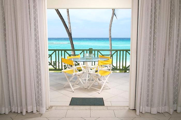 Bright yellow chairs and an ocean view