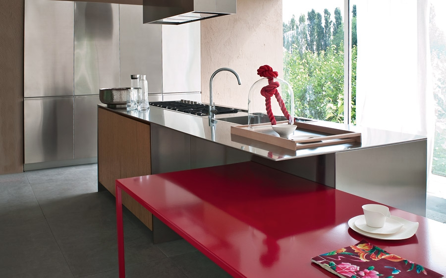Brilliant pops of red enliven the classy, contemporary kitchen from Elmar