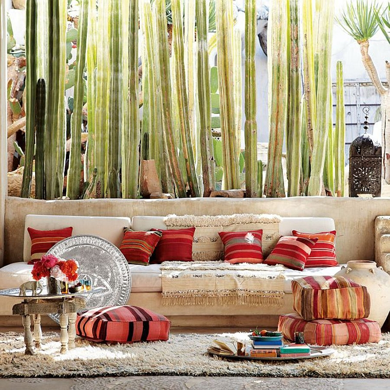 Casual and playful patio design with Moroccan rugs and throw pillows