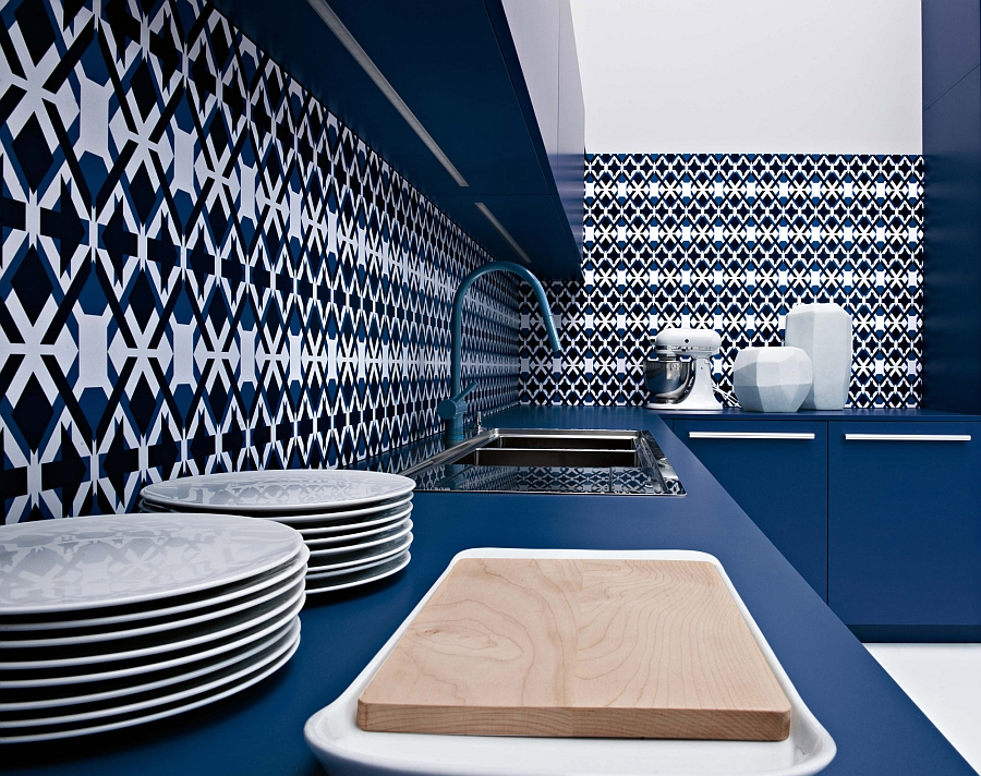 Colorful and posh backsplash in blue along with a countertop that compliments it