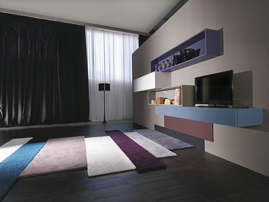 Colorful rugs complement the modular wall storage units with panache