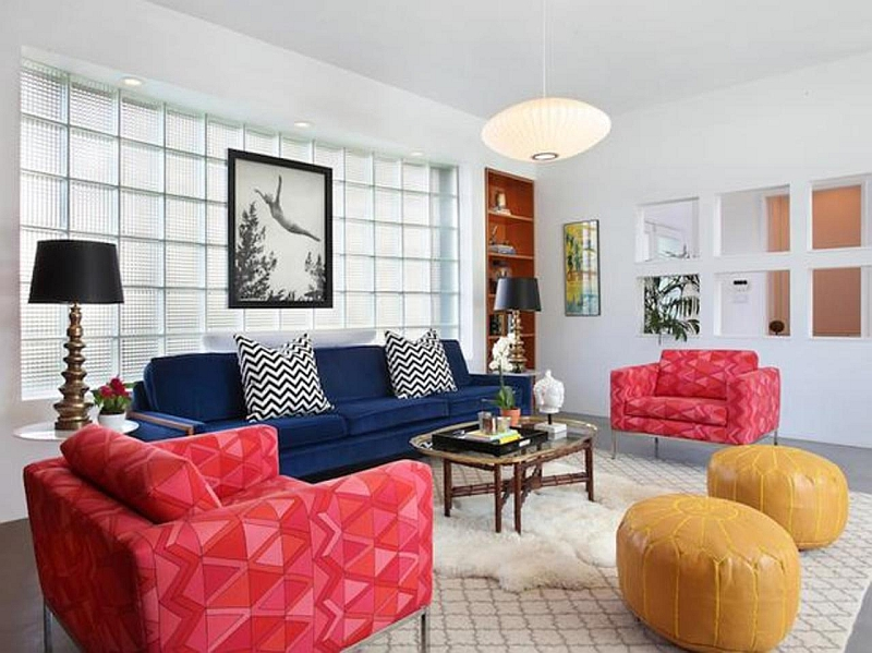 Combine trendy chevrom patterns with colorful ottomans in the living room