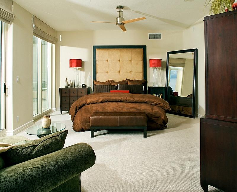 Comfort, style and masculine overtones meet in this modern bedroom