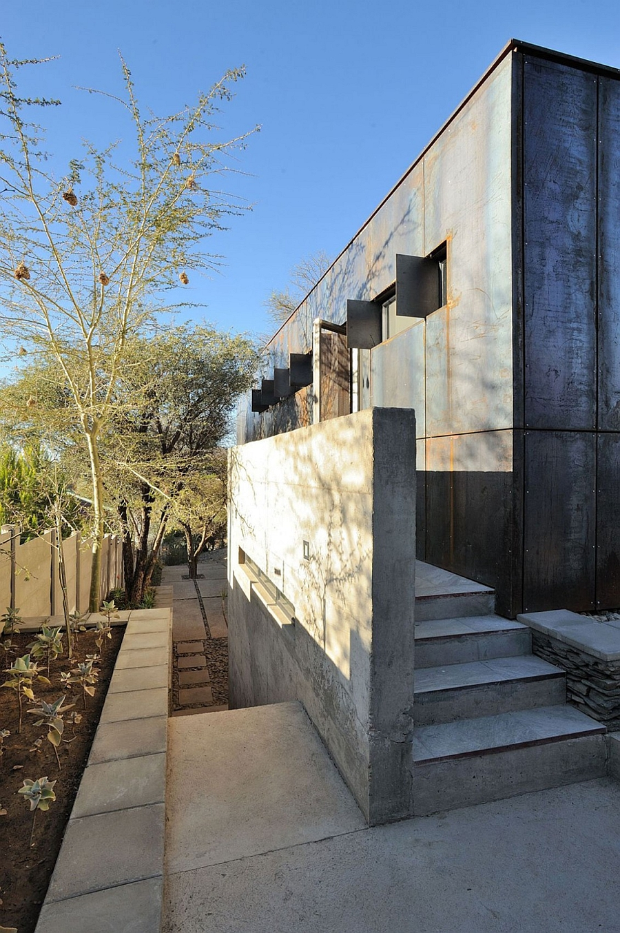 Concrete blocks were repurposed and used to shape the entrance