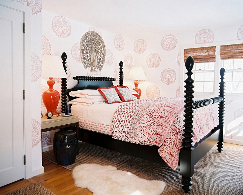 Contemporary bedroom with bright pops of orange