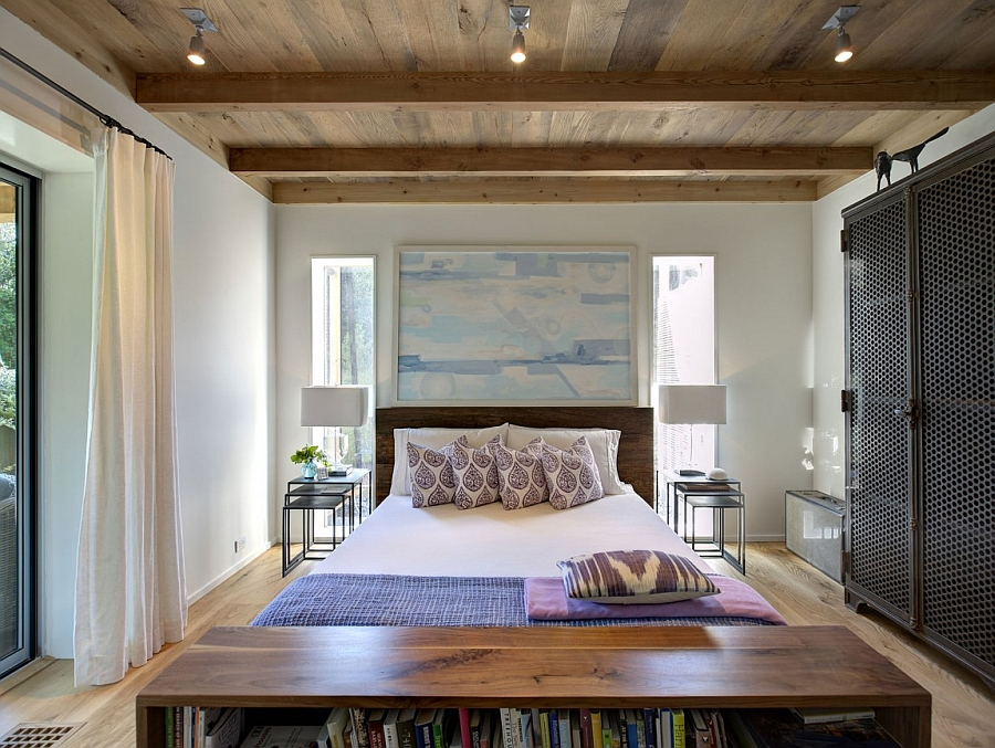Cozy bedroom with white walls and a ceiling clad in wood