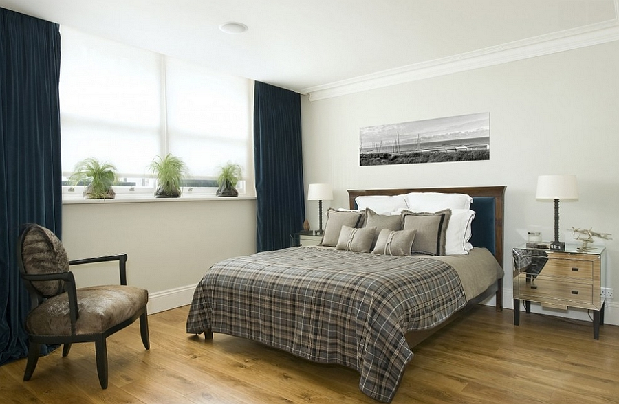Dark blue and light gray are ever-popular choices in bedrooms with a masculine vibe